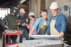 Free Group Of Industry Metal Construction Workers Stock Photo - 133657360
