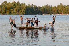 Free Group Of Kids Jumping Into Lake Royalty Free Stock Photos - 6359008