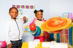 Free Group Of Kids Play With Solar System Planets Stock Photography - 144617302