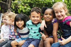 Free Group Of Kindergarten Kids Friends Arm Around Sitting And Smiling Fun Stock Photo - 102598720
