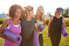 Free Group Of Mature Female Friends On Outdoor Yoga Retreat Walking Along Path Through Campsite Royalty Free Stock Photos - 166574158