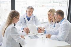 Free Group Of Medics Discuss X-ray Scan Stock Photos - 114549983
