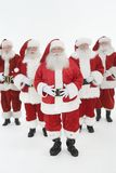 Group Of Men Dressed In Santa Claus Outfits Stock Photos