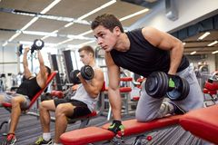 Group Of Men With Dumbbells In Gym Stock Photos