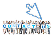 Group Of People Holding The Words Contact Us Stock Image