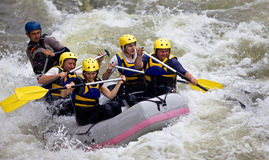 Free Group Of People Whitewater Rafting Royalty Free Stock Image - 21875776