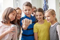 Free Group Of School Kids With Smartphone And Soda Cans Royalty Free Stock Photography - 72058817