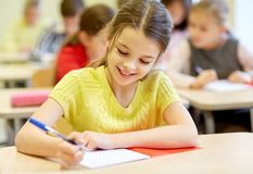Free Group Of School Kids Writing Test In Classroom Royalty Free Stock Images - 47831439