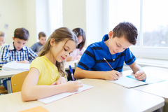 Free Group Of School Kids Writing Test In Classroom Stock Photography - 49273302