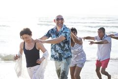 Free Group Of Seniors On The Beach Stock Images - 117272364