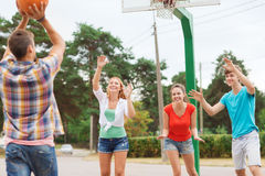 Group Of Smiling Teenagers Playing Basketball Stock Photography