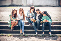 Group Of Students Sitting With A Books Stock Photo
