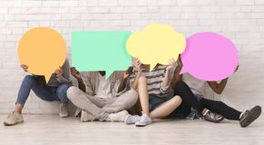 Free Group Of Teen Friends Covering Faces With Colorful Speech Bubbles Stock Photos - 173706733