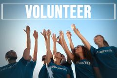 Free Group Of Volunteers Raising Hands Outdoors Stock Images - 161240974