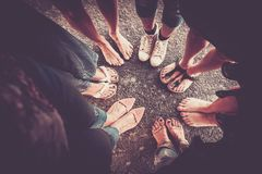 Free Group Of Woman From High Point Of View With Seven Pair Of Feet With Shoes And Barefoot Without. Caucasian Ladies In Summer Time. Stock Images - 141299144
