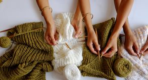 Free Group Of Woman Hand With Knitting Needles, Knit Wool White And Mossy Green Scarf For Winter Handmade Gift Stock Photo - 167763270