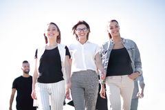 Free Group Of Young People Walking Together Stock Photos - 137328043