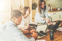 Free Group Of Young People Working Together.Man Is Using Laptop,girls Looking On Screen Of Laptop,discussing Business Plan. Stock Images - 102396234