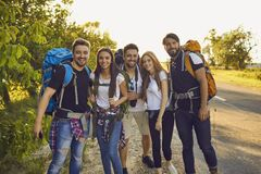 Free Group Of Young Tourists Hikers Standing And Looking At Camera Together During Summer Vacations Royalty Free Stock Images - 220557199