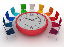 Group of office chairs at table as an clock put by half-round Royalty Free Stock Image