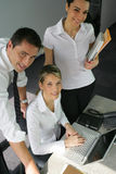 Group of office workers. Group of three business people working in the office Stock Photos