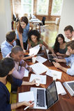 Group Of Office Workers Meeting To Discuss Ideas Stock Photography