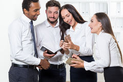 Group of office workers watching cat video Stock Photos