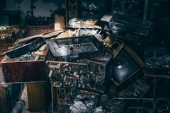 Group of old antique retro television or broken TV boxes in dark creepy abandoned house among garbage in dirty room. Toned Stock Image