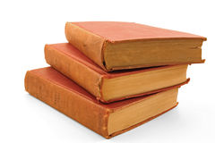 A group of old books. Three old books isolated on a white background royalty free stock image