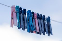Cloth pegs with a under the blue sky Royalty Free Stock Photos