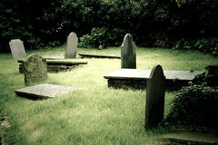 Group of old creepy cemetary tombstones - filter added Royalty Free Stock Photo