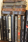 Group of old guitar case in music store Royalty Free Stock Images