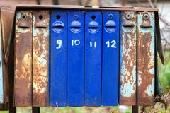 Group of old metal mail boxes. Close up of old vintage mail boxes royalty free stock image