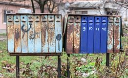 Group of old metal mail boxes. Close up of old vintage mail boxes stock photo