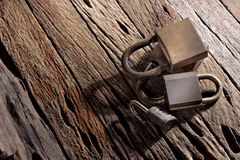 Group of old padlocks  on grunge wood background. Stock Image