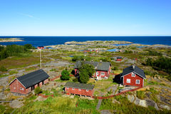 Group of old red houses in the archipelago Stock Photo