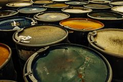 Group of old rusting metal drums. Photo of a group of rusting metal drums or industrial containers stock images