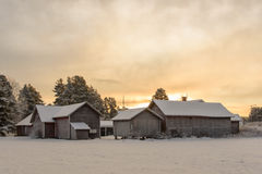 Group of old snowy farm houses Royalty Free Stock Photos