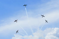 Group of old timer planes. Performing acrobatics in the air Royalty Free Stock Photos