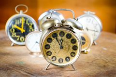 Group of old used alarm clocks. Obsolete technology but great design - Five to twelve royalty free stock images