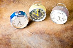 Group of old used alarm clocks red, blue- yellow. Obsolete technology but great design stock photo
