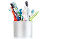 Group of old and used toothbrush in metal cup Stock Images