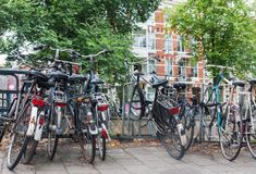 Group of old vintage bicycles parked on the street in Amsterdam. Group of old weathered vintage bicycles parked on the street in Amsterdam, Netherlands royalty free stock photos