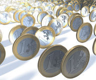 Group of one euro coins rolling past the viewer, blurry background Stock Images