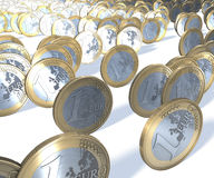 Group of one euro coins rolling past the viewer, in focus front to back Stock Image