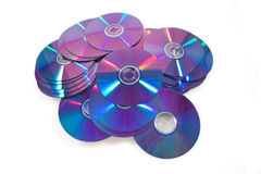 Group of optical disks on a white background. Group of optical disks (CD or DVD) on a white background Royalty Free Stock Photo