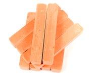 Group orange chalk. Stacked group orange chalk on white background Stock Image