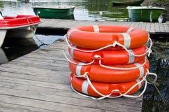 Group orange lifebuoy on wooden resort lake  pier Stock Photography