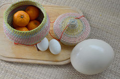 Group of oranges in bamboo container with duck egg and ostrich e Stock Photography