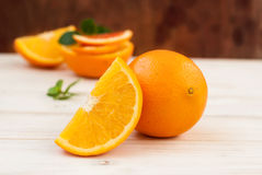 Group of oranges on the dark board Royalty Free Stock Photos